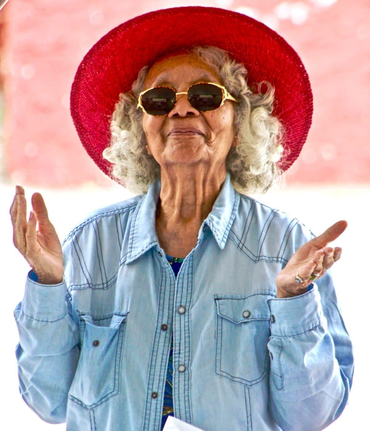 Happy elderly woman woman looking in mirro Elderly woman